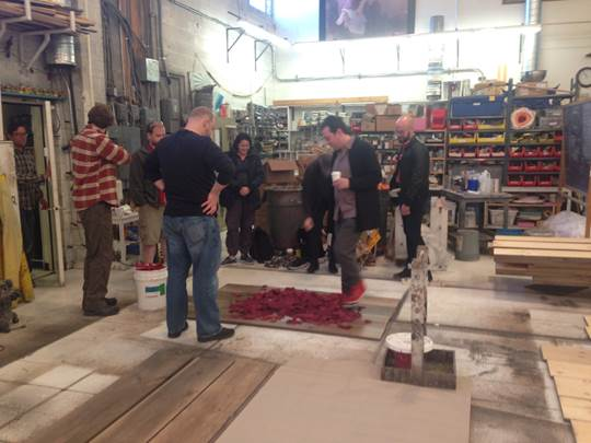The artistic team, including Director Alan Paul, visits the Paint Shop and tests out leaves.