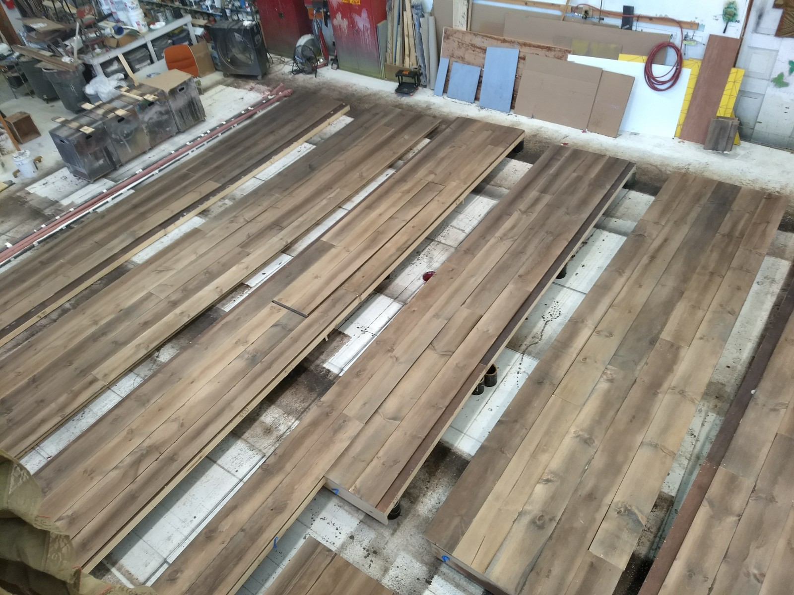 430 wooden planks were painted and sealed to cover the floor and walls for the set.