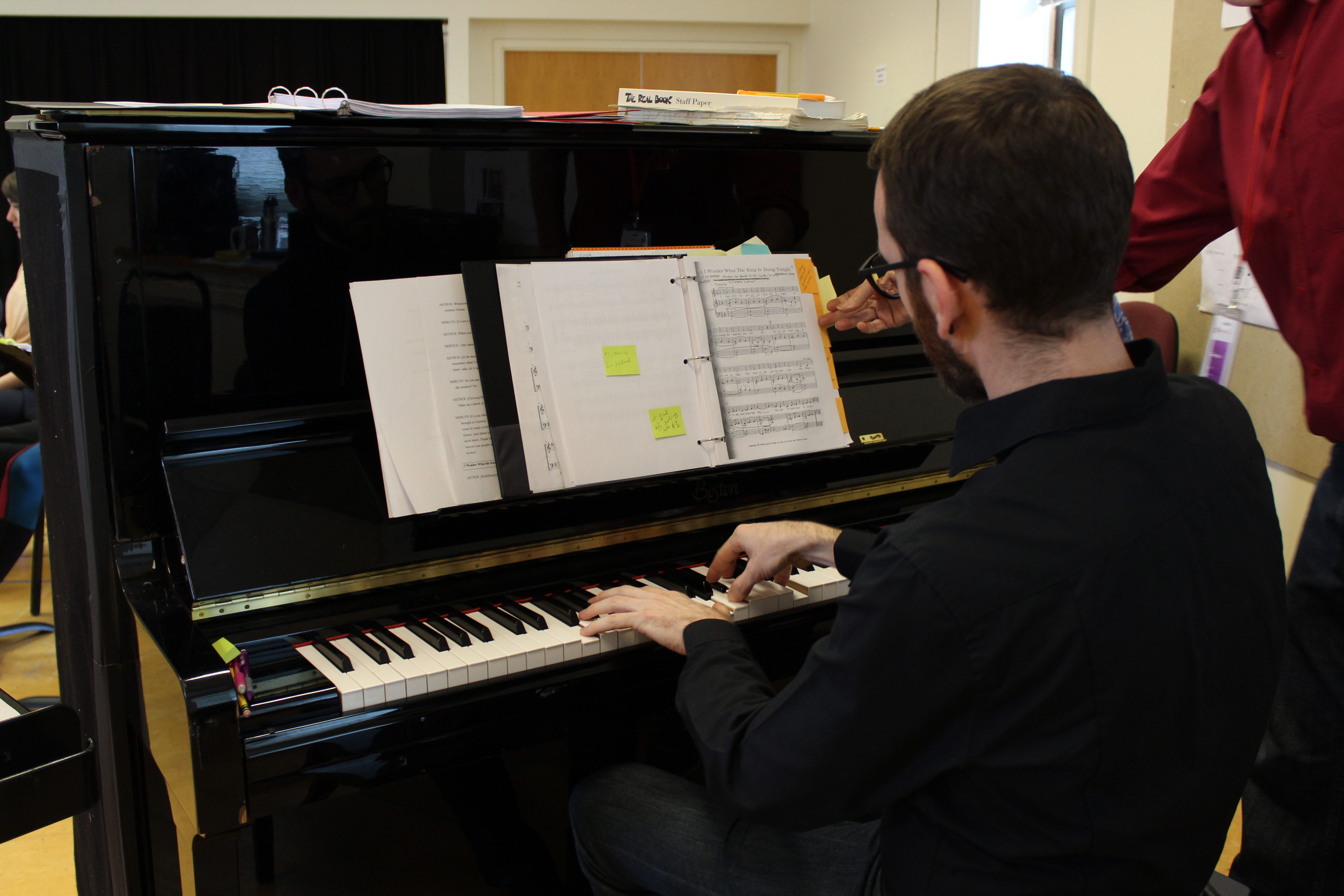 Photo of Music Director James Cunningham in rehearsal for Camelot.