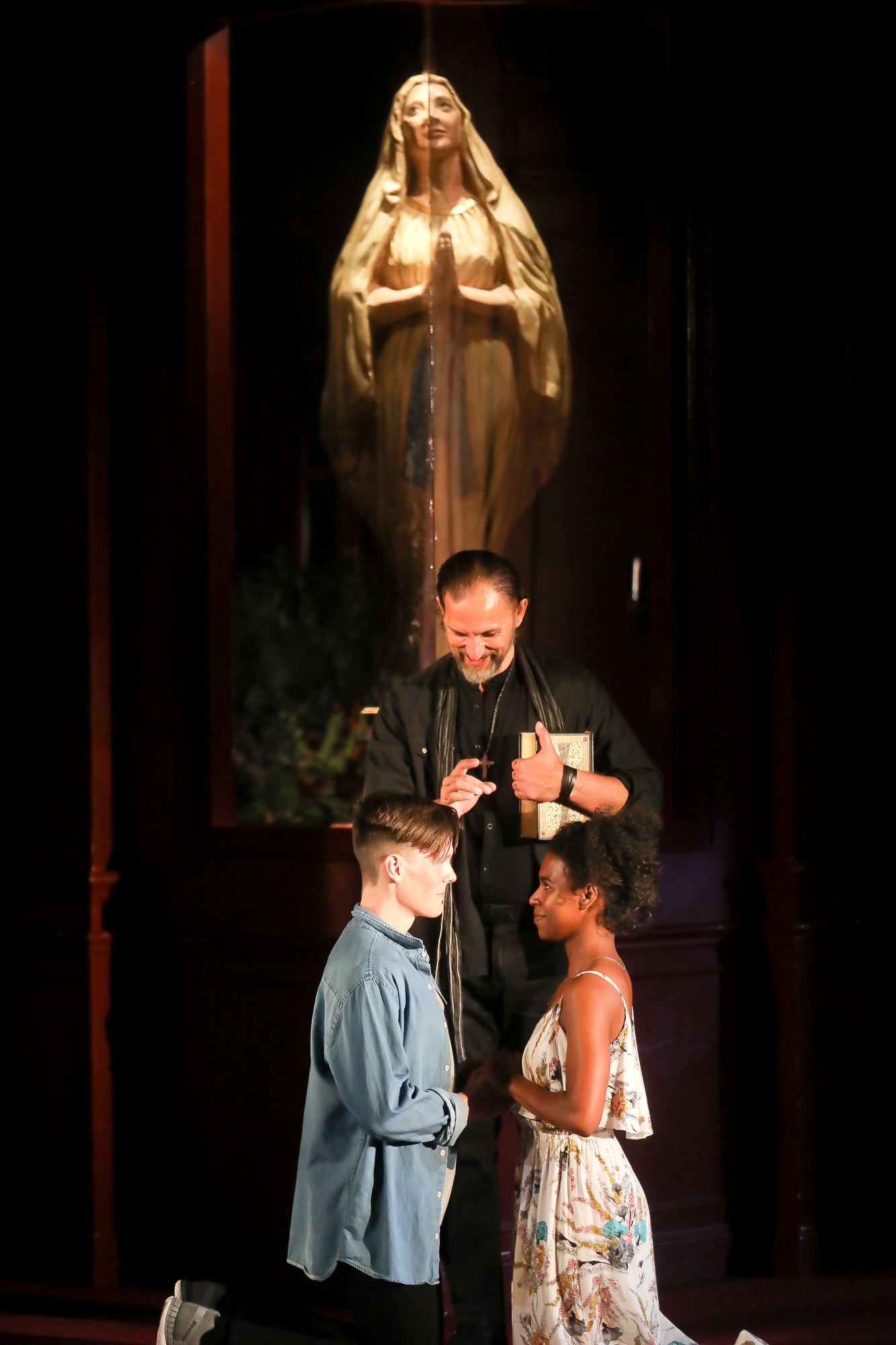 Photo of Ron Menzel as Friar Laurence, Danaya Esperanza as Juliet and Sam Lilja as Romeo in Romeo & Juliet by Tony Powell.