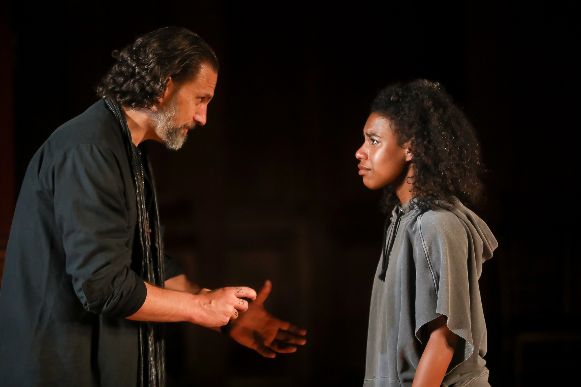 Photo of Ron Menzel as Friar Laurence and Danaya Esperanza as Juliet in Romeo & Juliet by Tony Powell.