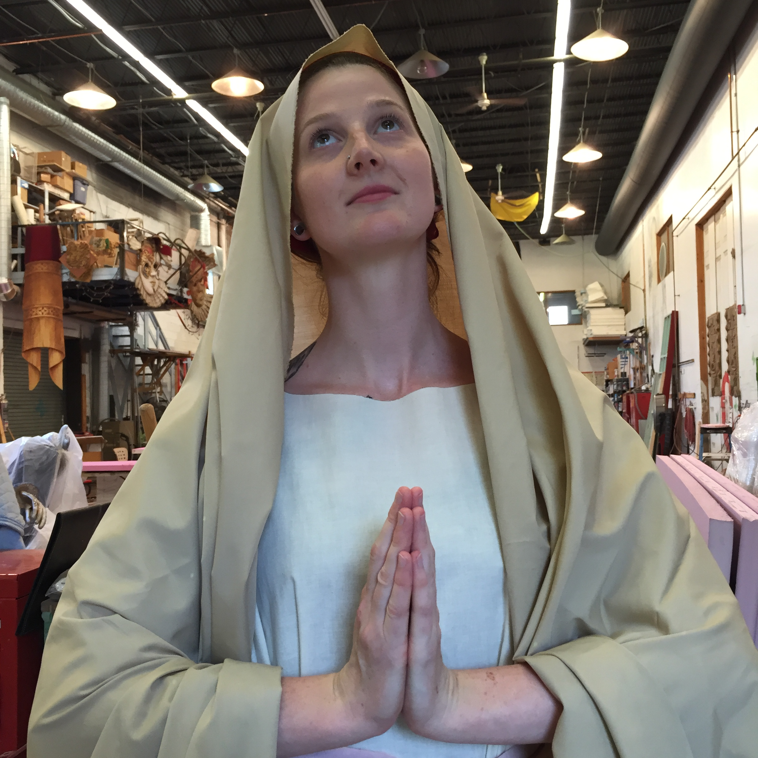 The Paint Shop's Laura Genson poses as a reference for the Madonna statue needed for ROMEO & JULIET.